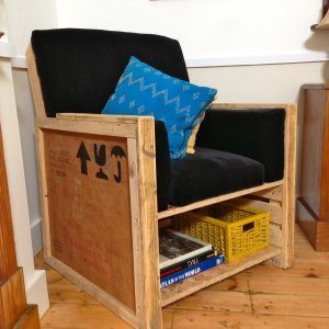 Pallet-packing-crate-upcycled-armchair-with-storage-shelf-made-from-reclaimed-materials