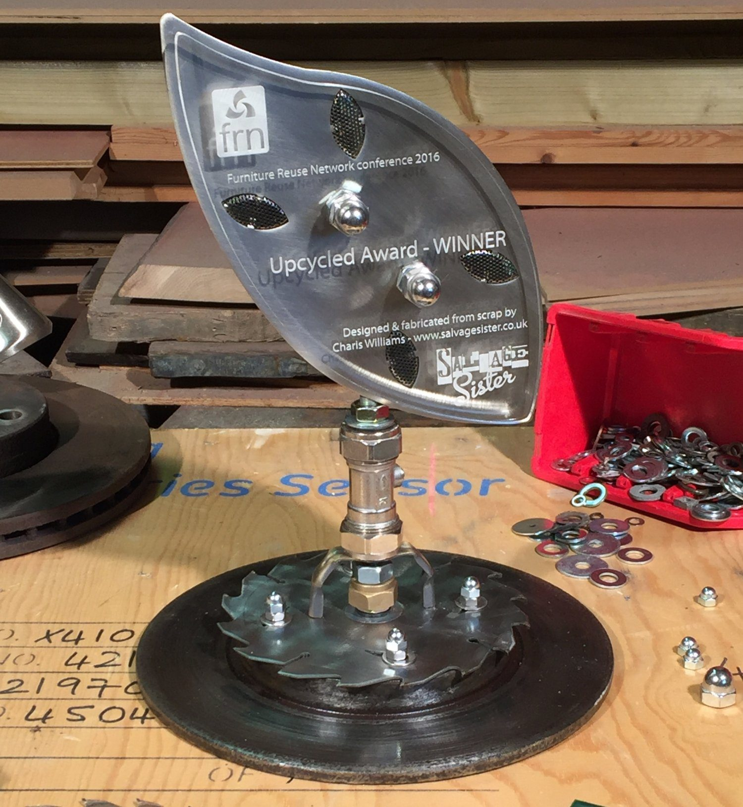 Upcycled metal trophy made from salvaged & reclaimed metal parts like fittings & circular saw blades