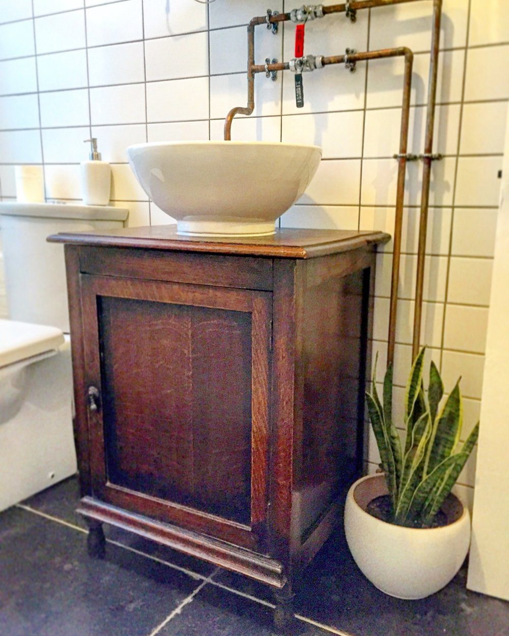basin installed on reclaimed wooden unit