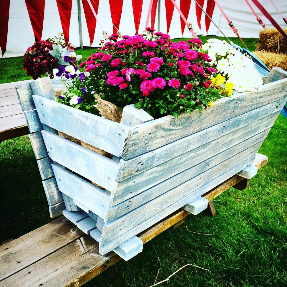 Painted garden pallet trough planter with coffee sack liner