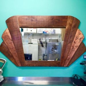Art-deco-window-mirror-frame-made-from-reclaimed-barn-cladding