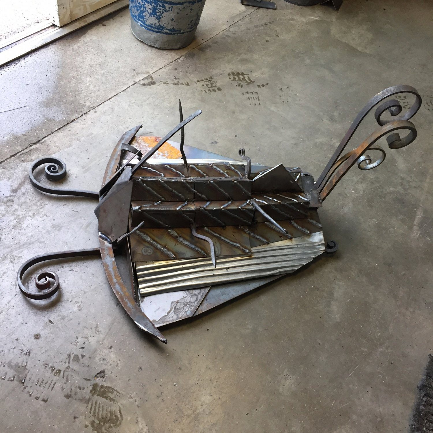 Trilobite sculpture made from scrap pieces of steel found in the the college forge and welding bays.