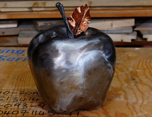 Steel apple sculpture – End world hunger