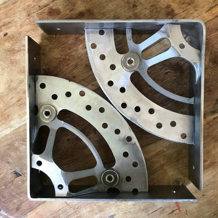 scaffold board shelf brackets made from motorcycle break disks