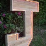 Massive wooden letter J with neon strip