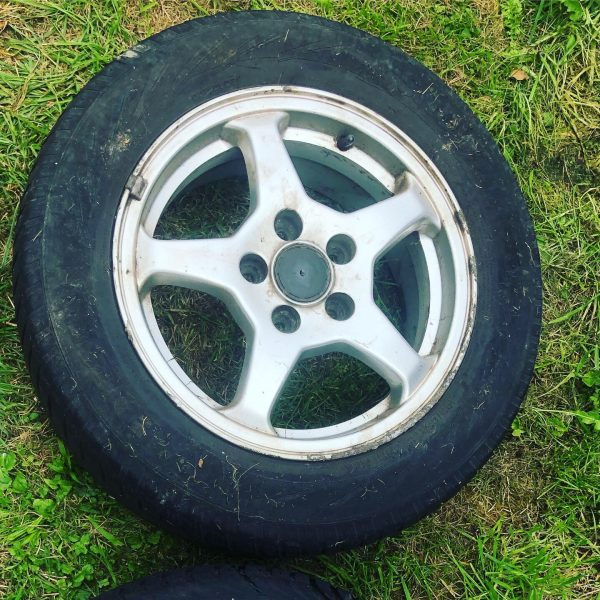 Salvaged alloy car wheel before upcycling