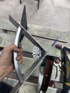 Handcrafted metal shelf brackets using bike salvage