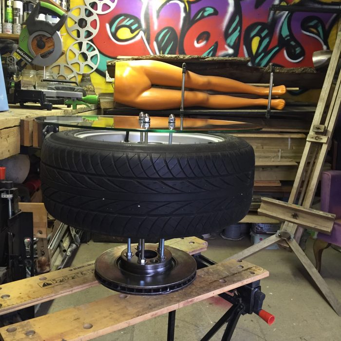 Industrial coffee table made from auto parts