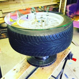 industrial style coffee table made from car wheel and break disk