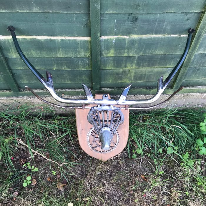 repurposed scrap metal into Stag head wall art