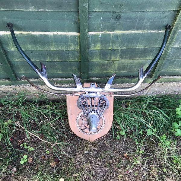repurposed scrap metal into Stag head wall art