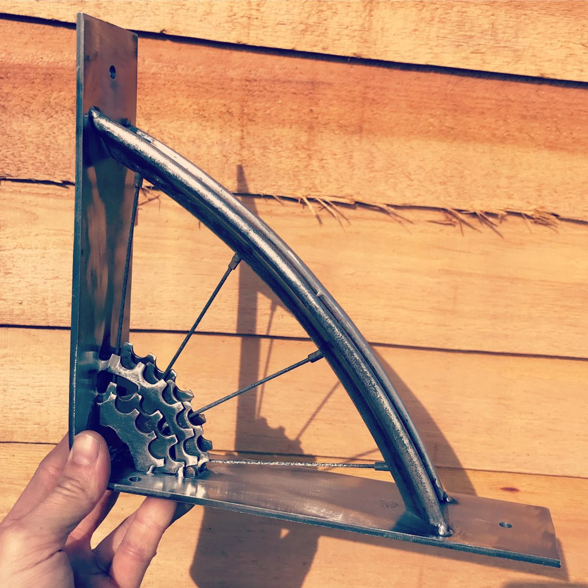 Handmade shelves shelf bracket from salvaged bike parts