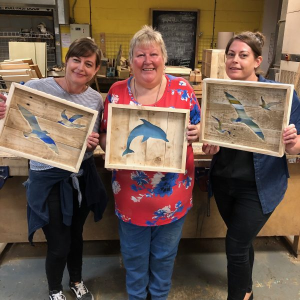 using pallets and a scrollsaw we created cut-out art