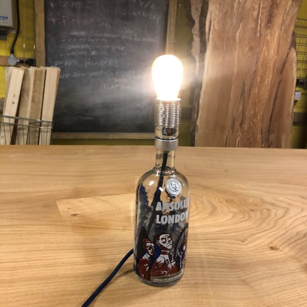 How to turn a bottle into a working electrical lamp