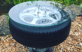 Car wheel coffee table with glass top