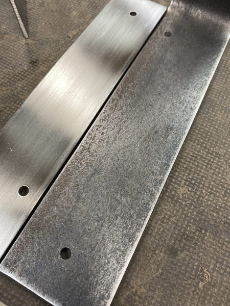 polished Stainless steel next to polished mild steel