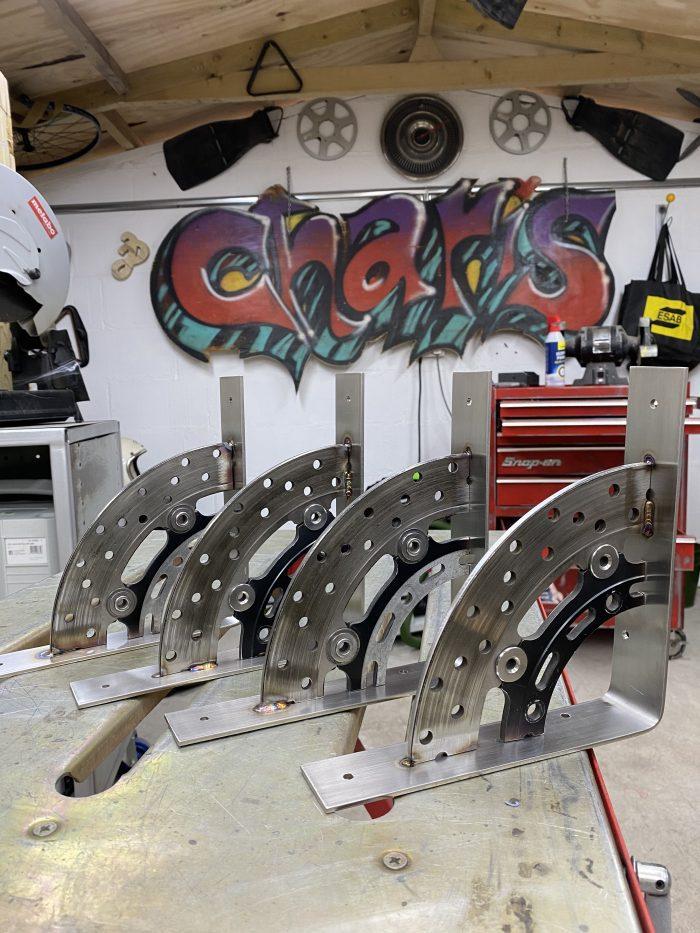 motorbike brake disk shelf brackets on stainless steel
