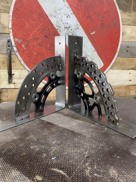 stainless steel next to mild steel brake disk shelf bracket