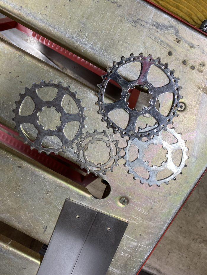 Bike gears ready to be cut up to make shelf brackets